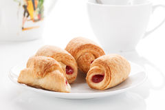 Cookies with filling. Pastry stuffed with lies in a bowl against a cup of tea stock photos
