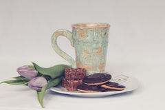 Cookies Flowers and Mug on Plate Stock Photo
