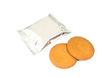 Cookies and foil package. On white background Stock Images