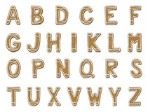 Gingerbread cookie alphabet isolated on white background. Cookies font letters set. Gingerbread cookie alphabet isolated on white background Stock Images