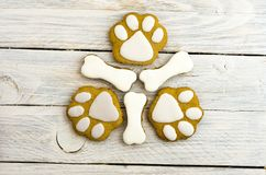 Cookies in the form of dog paws and bones. White background Stock Photos