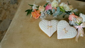 Cookies in the form of hearts. Wedding boutonnieres flowers stock video footage
