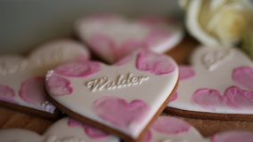 Cookies in the form of hearts. Wedding inscriptions. Pink cookie. S stock video