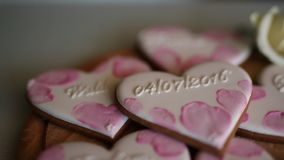 Cookies in the form of hearts. Wedding inscriptions. Pink cookie. S stock video footage