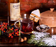 Cookies form of house decorated with mulled wine mug drink. Royalty Free Stock Photo