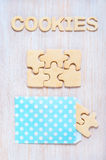 Cookies in the form of puzzles and letters on the table Royalty Free Stock Image