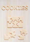 Cookies in the form of puzzles and letters on the table Stock Image