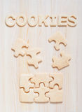 Cookies in the form of puzzles and letters on the table Royalty Free Stock Photos