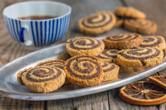 Cookies in the form of a spiral and a cup of tea. Royalty Free Stock Images