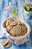 Cookies in the form of a spiral in a festive basket Stock Photo
