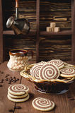 Cookies in the form of a spiral on a wooden table Royalty Free Stock Photography