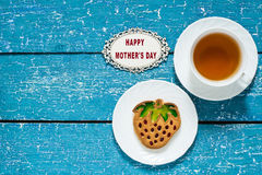 Cookies in the form of strawberries and tea for mom Royalty Free Stock Photos