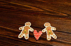 Cookies in the form of two men and a heart between them Royalty Free Stock Photo