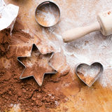 Cookies forms and gingerbread dough Royalty Free Stock Photos