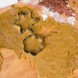 Cookies forms and gingerbread dough on wooden pastry board Royalty Free Stock Photo
