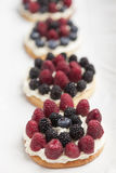 Cookies with fresh berries. Cookies with whipped cream and berries on white background Stock Photo