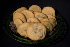 Cookies 6. Fresh home baked chocolate chip cookies displayed on a glass plate Royalty Free Stock Images
