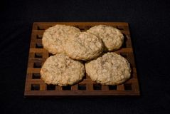 Cookies 10. Fresh home baked oatmeal cookies displayed on a wood hot plate Stock Photos