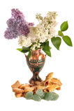 Cookies and fruit candy  near to a vase with a lilac. Cookies and fruit candy lay on a table near to a vase with a lilac Royalty Free Stock Photography