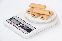 Cookies with fruit filling on the digital scale Stock Image