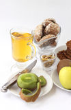 Cookies and fruit1. Kiwi, apples, cookies with a peanut, gingerbreads, juice, pistachios on the gray background Royalty Free Stock Image