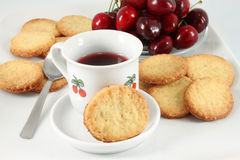 Cookies and fruit tea, cherry Royalty Free Stock Images