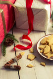 Cookies and gifts at Christmas time Stock Images