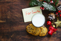 Cookies and a glass of milk for Santa Stock Images
