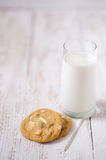 Cookies and glass of milk. Wooden background Stock Photos