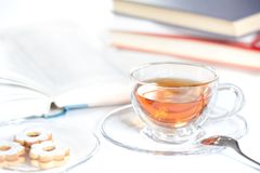 Cookies, glass of tea and books Royalty Free Stock Photo