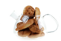 Cookies in glass teapot Stock Image