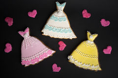 Cookies with glaze in the form of dress. Stock Photos
