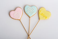 Cookies with glaze in the form of hearts. Stock Photography