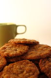 Cookies with a green cup. Muesli cookies with a cup of milk Stock Images
