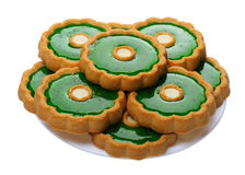Cookies with green jelly on white plate, isolated Stock Photos