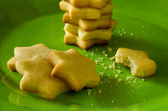 Cookies on green plate Royalty Free Stock Image