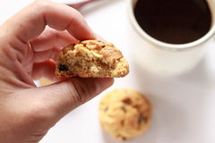 Cookies with hand. And cup coffee on white Stock Image