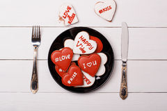 Cookies heart lie on a plate. Valentine's Day. Wooden texture Stock Image