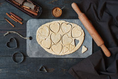 Cookies-hearts cut out of the dough. On the vintage wooden table Royalty Free Stock Photography