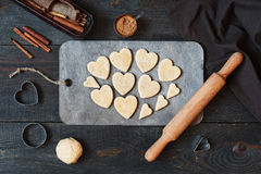 Cookies-hearts cut out of the dough. On the vintage wooden table Royalty Free Stock Images