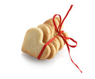 Cookies-hearts with red ribbon Stock Photos