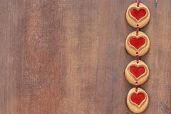 Cookies hearts on a wooden background Royalty Free Stock Photos