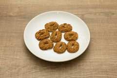 Cookies with a hole, sweet temptation. Dessert on white dish and Royalty Free Stock Images