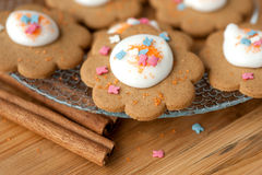 Cookies with icing and cinnamon sticks Royalty Free Stock Photography