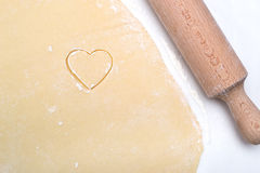 Cookies In The Shape Of A Heart Cut Out Of The Dough Stock Photography