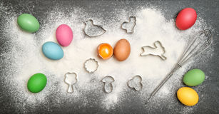 Cookies ingredient and colored easter eggs Royalty Free Stock Image