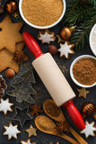 Cookies and ingredients for Christmas baking, vertical, top view Royalty Free Stock Photo