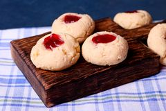 Cookies with jam, biscuits on a brown desk Royalty Free Stock Photos