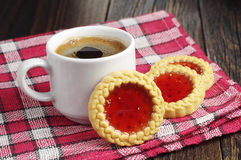 Cookies with jam and coffee cup Stock Images