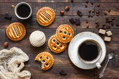 Cookies with jam and coffee on wooden table Royalty Free Stock Images